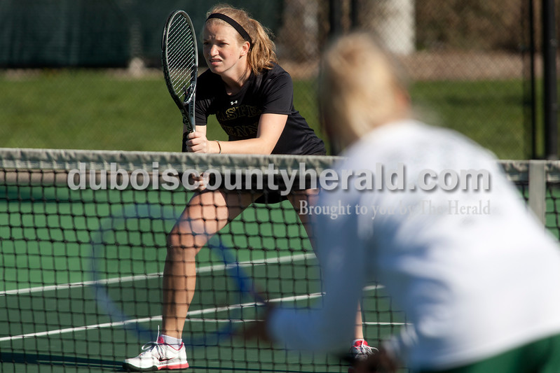 Jasper's Mekenzie Hilsmeyer prepared herself as her No. 2 doubles partner Brooke Lueken served the ball during Saturday's match against Greenwood in Jasper. Dave Weatherwax/The Herald