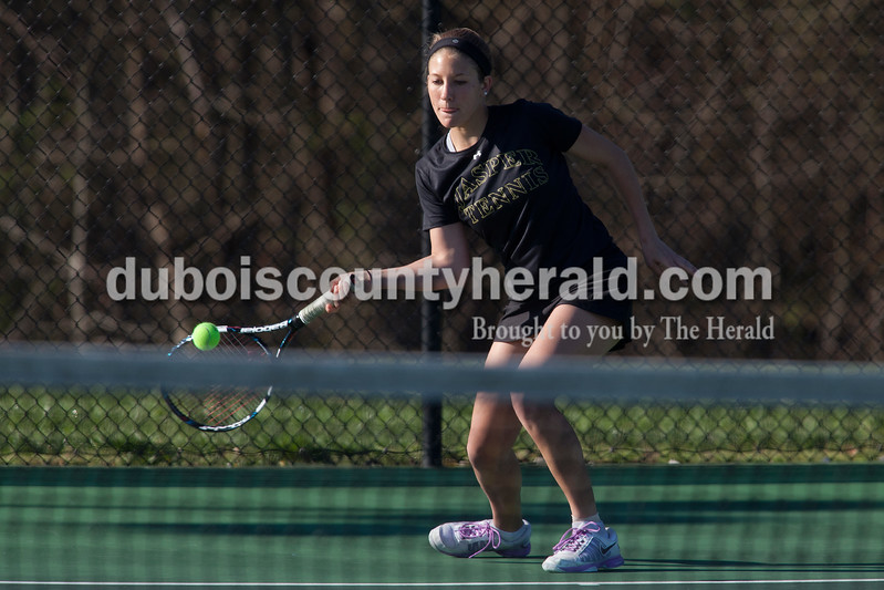 Jasper's Anna Flick returned the ball during the No. 3 singles match of Saturday's match against Greenwood in Jasper. Dave Weatherwax/The Herald