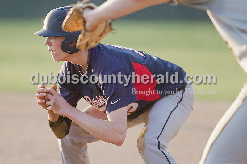 Rachel Mummey/The Herald<br /> Heritage Hills' Nick Waninger stood ready to run at first base during Monday night's game against Jasper in Lincoln City. Jasper won 9-0.