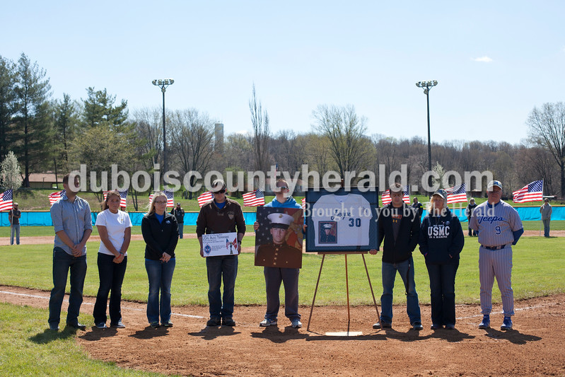 Dave Weatherwax/The Herald<br /> Family and friends of the fallen Marine Lance Cpl. Alec Terwiske gathered at home plate Saturday during a break between games in the Northeast Dubois Baseball Classic for a dedication ceremony in Alec's honor in Dubois.