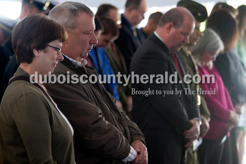 The parents of fallen Marine Cpl. Eric Lueken, Melinda, left, and Jake, were among the family and friends on hand for a ceremony Monday morning in which the natural resources building at Crane Division, Naval Support Activity was dedicated in honor of Eric.  Dave Weatherwax/The Herald