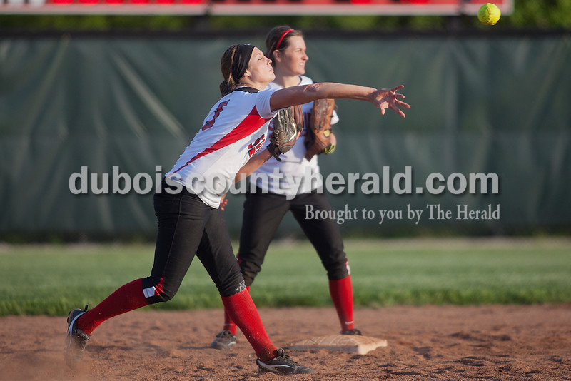Rachel Mummey/The Herald<br /> Southridge's Kendyl Dearing threw the ball to first base during Monday night's game against Northeast Dubois in Huntingburg. Southridge won 6-4.
