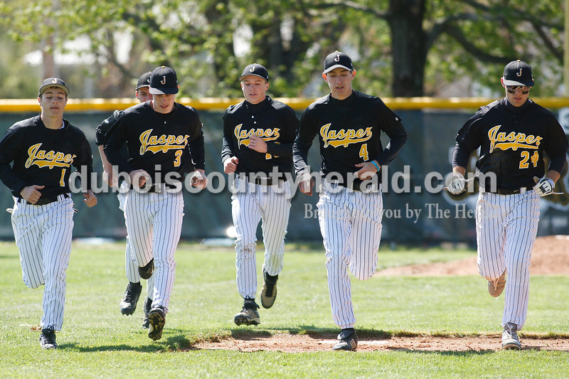 Jasper's Jacob Seibert, left, BLANK, Brayden Betz, BLANK, Seth Hollinden and Craig Schneider ran a warm-up in between innings during Jasper's game Saturday against Columbus East at Ruxer Field. Matthew Busch/The Herald