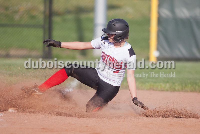 Rachel Mummey/The Herald<br /> Southridge's Kendyl Dearing slid safety into third base during Monday night's game against Northeast Dubois in Huntingburg. Southridge won 6-4.
