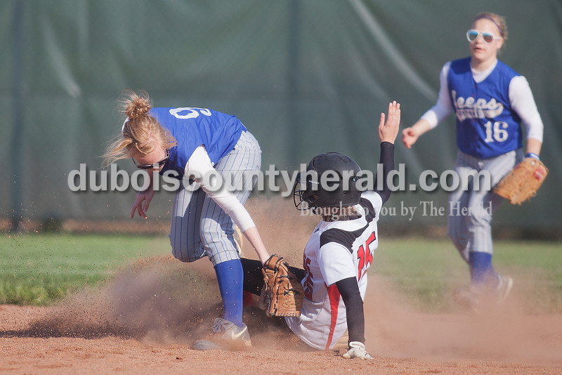 Rachel Mummey/The Herald<br /> Northeast Dubois' Chloe Johnson attempted a tag out on Southridge's Kabrea Robling during Monday night's game in Huntingburg. Southridge won 6-4.