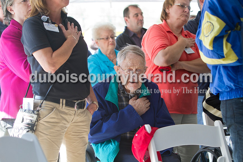 St. Charles Health Campus resident and World War II veteran Vincent Schmitt put his hand over his heart and sang along to the National Anthem at the start of the ceremony Monday morning at the Crane Division, Naval Support Activity.  Dave Weatherwax/The Herald