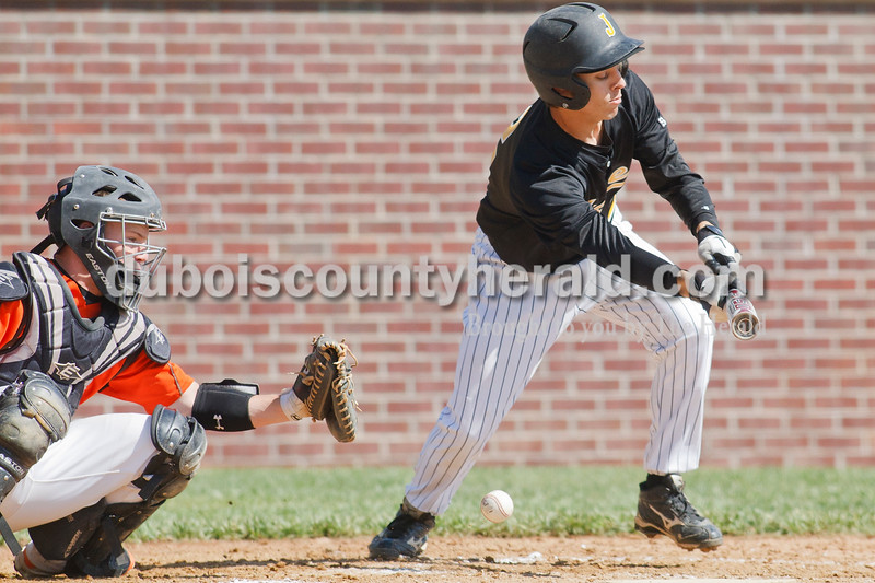 Matthew Busch/The Herald<br /> Jasper's Andy Knust tipped the ball into the dirt as he tried to lay down a bunt during Jasper's game Saturday against Columbus East at Ruxer Field. Columbus East's Christian Wichman was catching.