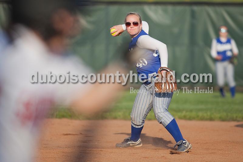 Rachel Mummey/The Herald<br /> Northeast Dubois' Taryn Friedman fielded a ground ball to first base during Monday night's game against Southridge in Huntingburg. Southridge won 6-4.