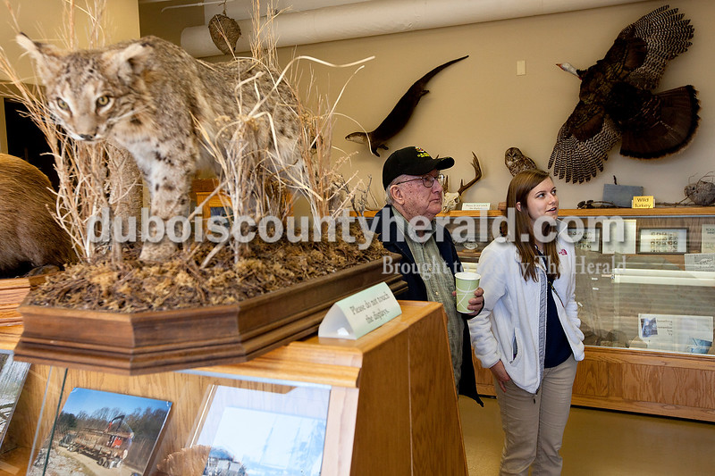 Louie Lueken, left, and his granddaughter Kendall Humbert of Dubois looked at the exhibits inside the natural resources building at Crane Division, Naval Support Activity following the ceremony in which the building was renamed in Louie's grandson's honor. Dave Weatherwax/The Herald