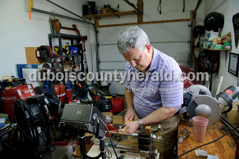 Matthew Busch/The Herald<br /> Steve Dills filed down small blocks of wood in his garage Wednesday afternoon to make pens for the organization Freedom Pens that will then send them to soldiers overseas. It takes Dills around half an hour to mill each pen. He has made around 50 so far, oftentimes milling them whenever he has the chance at home on his homemade lathe, the machine that actually spins the pieces of wood.