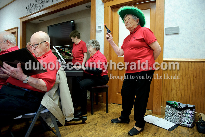 "Matthew Busch/The Herald<br /> Fern Bonifer of Ireland, right, popped a cap gun in rythym with the song ""Pistol Packing Momma,"" as the Singing Seniors from Dubois County sang songs for the residents at the Northwood Retirement Community in Jasper. The group travels to area nursing homes once a month to sing for residents."