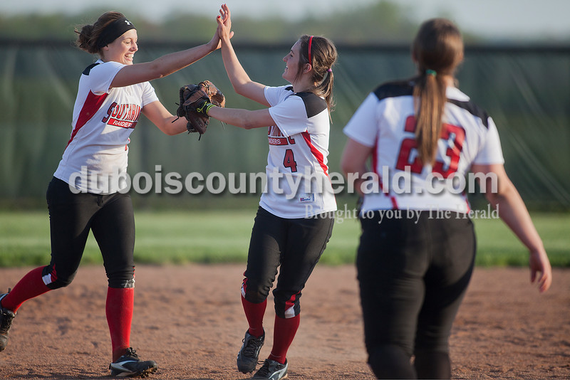 Rachel Mummey/The Herald<br /> Southridge's Kendyl Dearing and Robin Hanebutt high fived after making the winning play during Monday night's game against Northeast Dubois in Huntingburg. Southridge won 6-4.