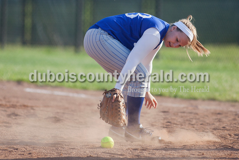 Rachel Mummey/The Herald<br /> Northeast Dubois' ___ fielded a ground ball during Monday night's game against Southridge in Huntingburg. Southridge won 6-4.