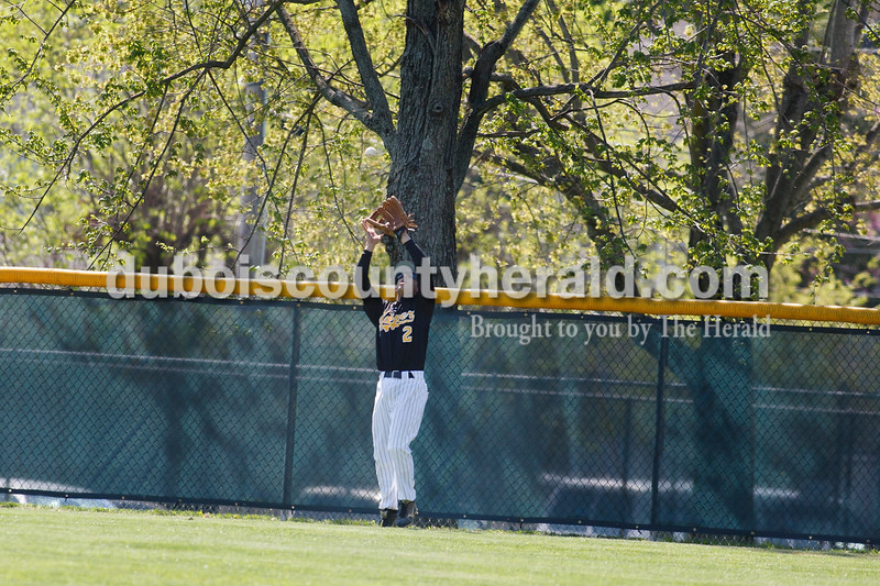 Jasper's Andy Knust caught a fly ball in right field next to the fence during Jasper's game Saturday against Columbus East at Ruxer Field. Matthew Busch/The Herald