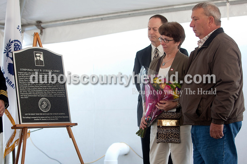 Jake Lueken of Dubois, right, and his wife, Melinda, were among the family and friends on hand for a ceremony Monday morning in which the natural resources building at Crane Division, Naval Support Activity was dedicated in honor of the Luekens' son, fallen Marine Cpl. Eric Lueken. A plaque that will be placed on the building was unveiled during the ceremony. State Rep. Mark Messmer, R-Jasper, was also present during the ceremony. Dave Weatherwax/The Herald