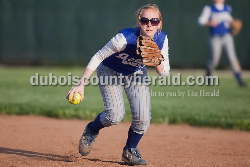 Rachel Mummey/The Herald<br /> Northeast Dubois' Chloe Johnson fielded a ground ball during Monday night's game against Southridge in Huntingburg. Southridge won 6-4.
