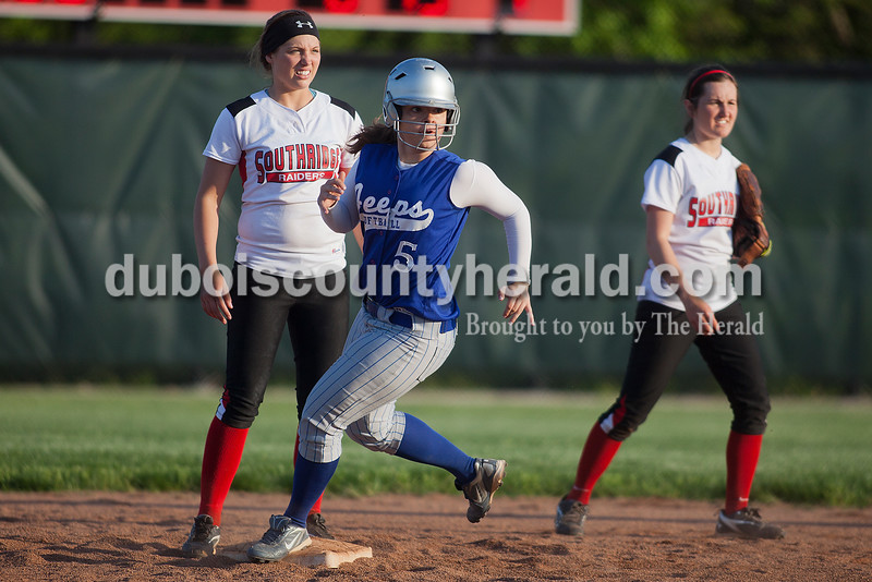 Rachel Mummey/The Herald<br /> Northeast Dubois' Michelle Seitz stole second base as Southridge's Kendyl Dearing and Robin Hanebutt played defense during Monday night's game in Huntingburg. Southridge won 6-4.
