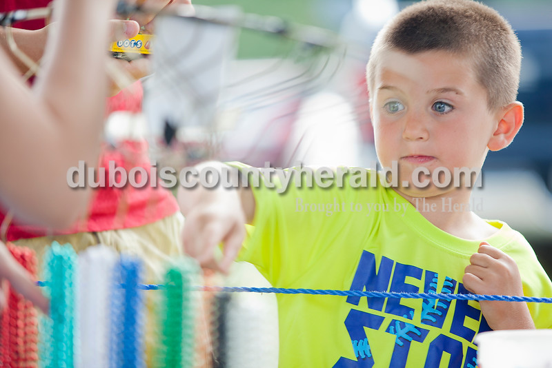 Heith Steckler of St. Henry, 5, picked out a prize after playing the duck pond game during the Heinrichsdorf Fest on the Catholic Knights of America grounds in St. Henry on Friday . Rachel Mummey/The Herald