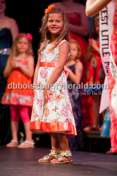 Rachel Mummey/The Herald<br /> Avari Schneider of Ferdinand, 7, smiled as she was named Lil Miss Heimatfest during the Heimatfest Queen Pageant at Forest Park High School on Sunday.