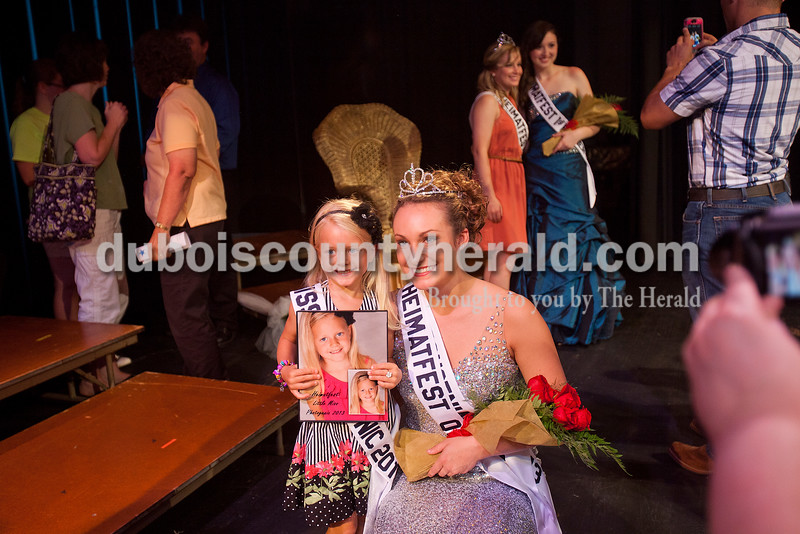 Shanna Hoffman of Ferdinand, 18, right, posed for a photo with Little Miss Photogenic winner Riley Hoffman of Ferdinand, 5, after Hoffman was named the 2013 Miss Heimatfest Queen following the pageant Sunday night in the auditorium at Forest Park High School in Ferdinand. Rachel Mummey/The Herald