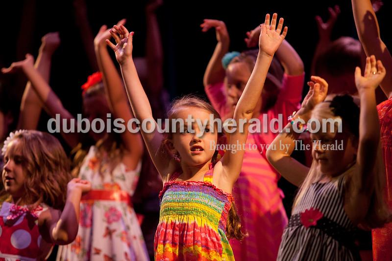 Rachel Mummey/The Herald<br /> Lil Miss Heimatfest contestant Addison Schipp of Ferdinand, 6, danced <br /> during the Heimatfest Queen Pageant at Forest Park High School on Sunday.