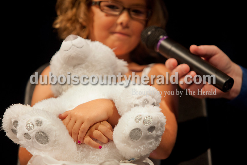 Rachel Mummey/The Herald<br /> Lil Miss Heimatfest contestant Kiersten Hubbs of Ferdinand, 6, held her stuffed polar bear during the My Favorite Things portion of the Heimatfest Queen Pageant at Forest Park High School on Sunday.
