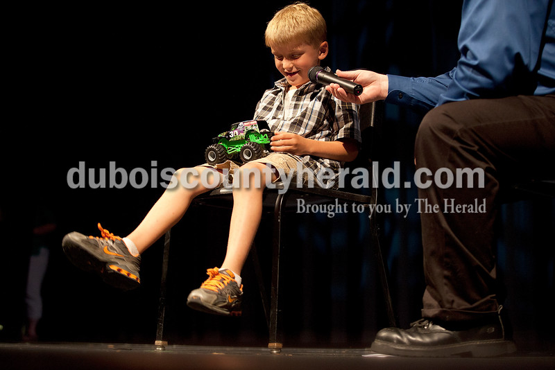 Rachel Mummey/The Herald<br /> Lil Mister Heimatfest contestant Cody Brames of Huntingburg, 7, talked about his toy monster truck the Gravedigger during the My Favorite Things portion of the Heimatfest Queen Pageant at Forest Park High School on Sunday.