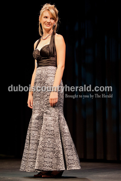 Jordan Buechler of Ferdinand, 17, posed in her evening gown during the Heimatfest Queen Pageant in the auditorium at Forest Park High School on Sunday in Ferdinand. Rachel Mummey/The Herald