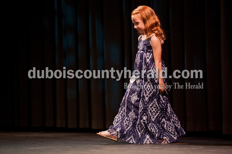Rachel Mummey/The Herald<br /> Lil Miss Heimatfest contestant Kaelyn Backer of Ferdinand, 5, walked out to greet the crowd during the Heimatfest Queen Pageant at Forest Park High School on Sunday.