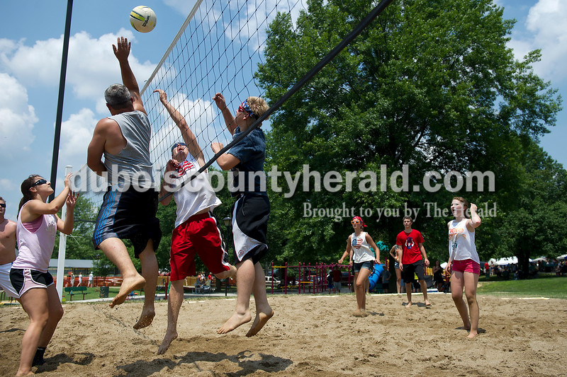 Alyssa Simmers of Jasper, left,  and Rocky Schultz of Eckerty attempted to defend the net against  Reece Heilers and Joel Weyer, both of Ferdinand, during the volleyball tournament at Heimatfest in Ferdinand on Saturday. Matthew Busch/The Herald