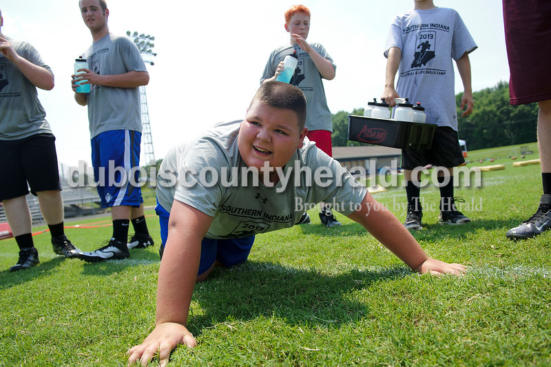 Heritage Hills Middle School eighth-grader Seth Thomas took a break from pushups after missing part of a drill during the Southern Indiana Football and Life Skills Camp at Heritage Hills High School on Friday. Matthew Busch/The Herald