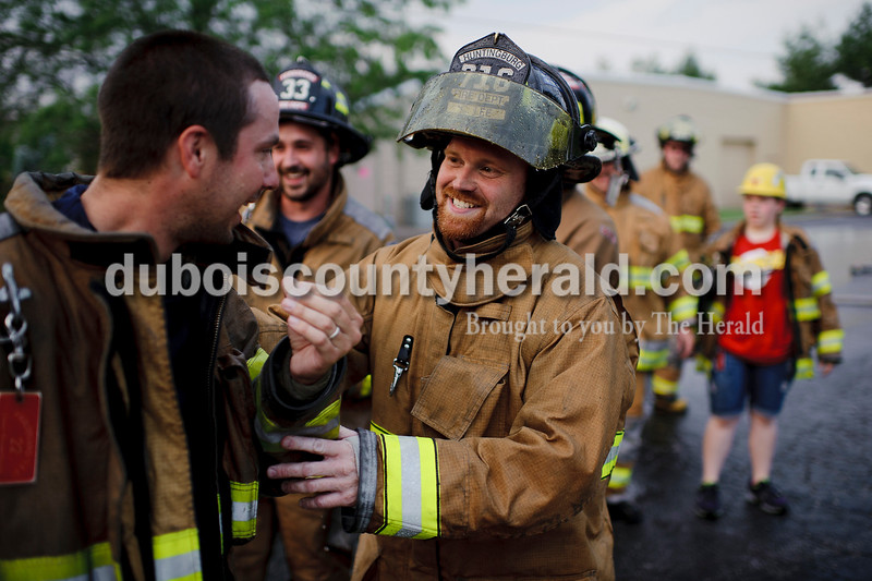 Chris Lee of the Huntingburg Volunteer Fire Department, right, joked with Grant Kippenbrock of the Ferdinand Volunteer Fire Department after the two faced off in a round of waterball during Heimatfest in Ferdinand on Friday.   Matthew Busch/The Herald
