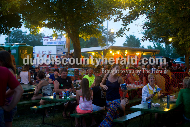 People gathered bout outside and inside the beer garden during Heimatfest in Ferdinand on Friday night. Matthew Busch/The Herald