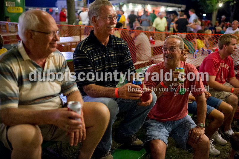 Tom Schipp, left, Dewey Durcholz and Petsy Oeding, all of Ferdinand, enjoyed a beer together at Heimatfest  in Ferdinand on Friday. The group of guys grew up together in Ferdinand and said they remembered when they used to pack the dance halls around Dubois County on nights like Friday.  Matthew Busch/The Herald