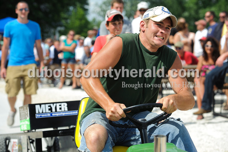Bubba Fleck of Jasper tried his hardest to pull the weight behind him  during the Celestine Street Fest on Saturday.  Matthew Busch/The Herald