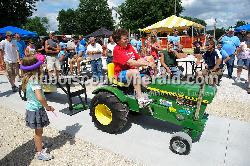Matthew Busch/The Herald<br /> Annette Schepers of Celestine competed in the adult tractor pull during the Celestine Street Fest on Saturday. Schepers is 63.