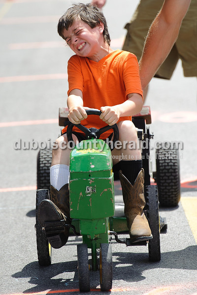 Jake Epple of St. Anthony, 9, participated in the kid tractor pull during the Celestine Street Fest on Saturday.  Matthew Busch/The Herald
