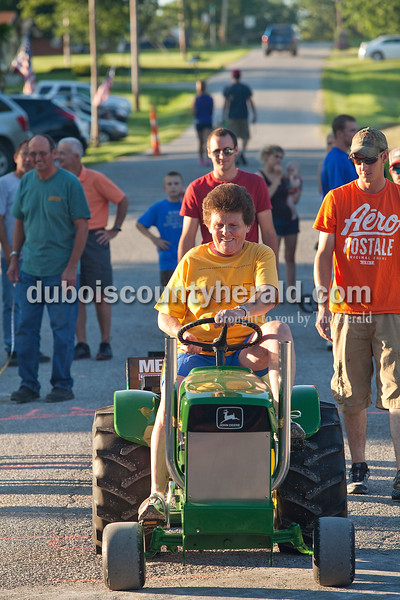 Annette Schepers of Celestine participated in the adult tractor pull at  Haysville Park during the 51st annual Haysville Sommerfest on Friday. Rachel Mummey/The Herald