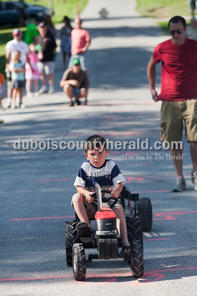 Brayden Weinel of Jasper, 5, participated in the kiddie tractor pull at the Haysville Park during the  51st annual Haysville Sommerfest on Friday. Rachel Mummey/The Herald