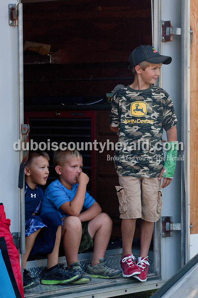 Reid Doty, 7, left, Clayton Seitz, 7, and Gaige Schepers, 8, all of Jasper, watched the kiddie tractor pull at the Haysville Park during the  51st annual Haysville Sommerfest on Friday. Rachel Mummey/The Herald