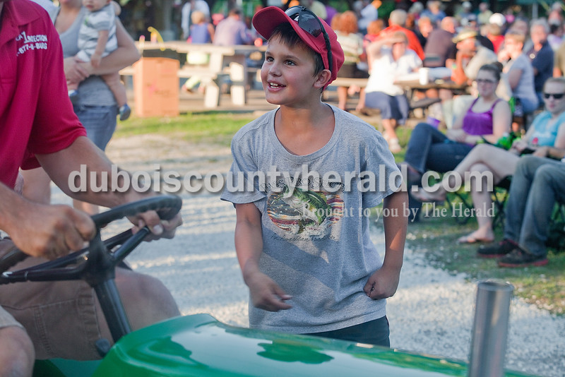 Wade Graber of Loogootee, 9, cheered on his dad, Coy, as he participated in the adult tractor pull at Haysville Park during the  51st annual Haysville Sommerfest on Friday. Rachel Mummey/The Herald