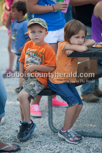 Kaegin O'Brian of Crystal, 3, left, and his sister Elaina, 4, waited for their turn in the kiddie tractor pull at Haysville Park during the  51st annual Haysville Sommerfest on Friday. Rachel Mummey/The Herald