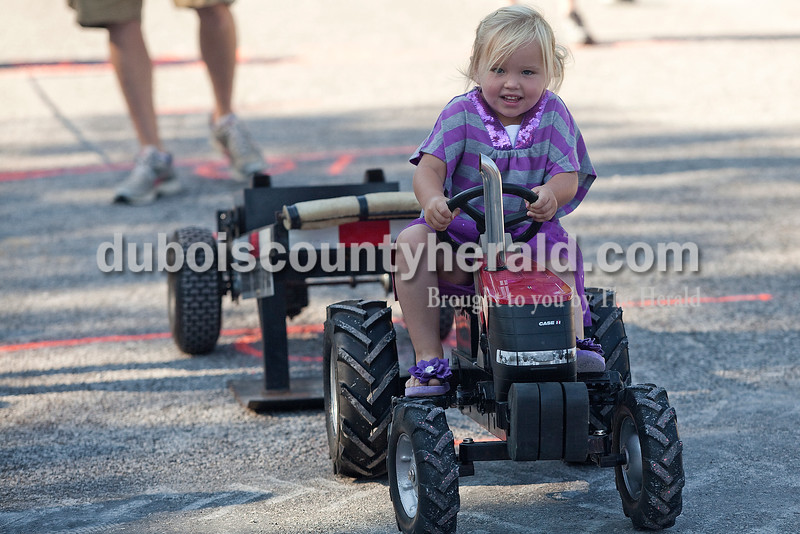 Kinley Schnell of Jasper, 3, participated in the kiddie tractor pull at Haysville Park during the  51st annual Haysville Sommerfest on Friday. Rachel Mummey/The Herald