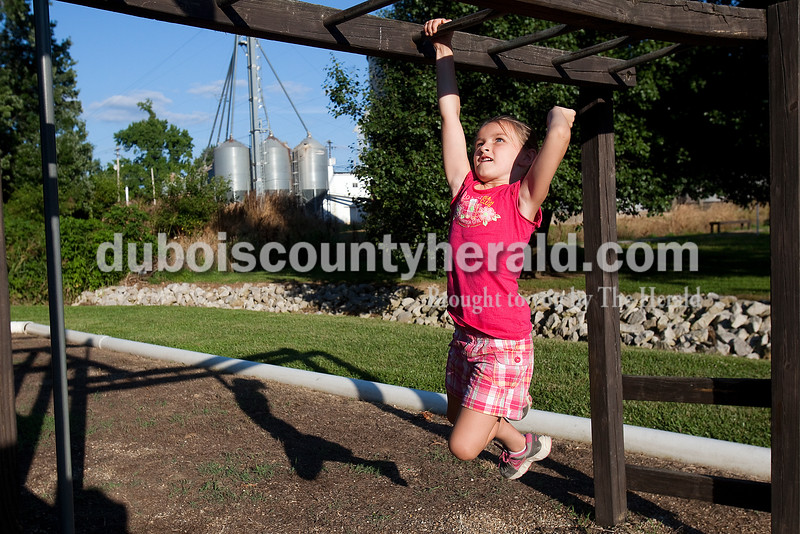 Kerrigan Kieffner of Jasper, 6, raced across the monkey bars at Haysville Park during the  51st annual Haysville Sommerfest on Friday. Rachel Mummey/The Herald