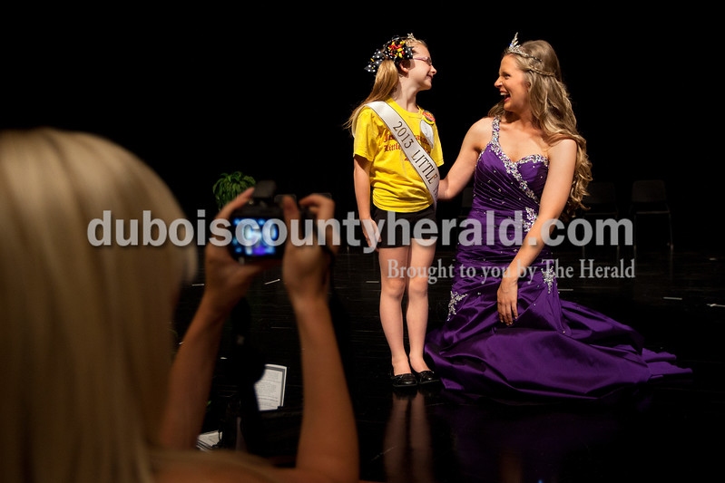 The newly crowned 2013 Little Miss Strassenfest Serenidy Eckerle of Jasper, 7, was congratulated by the 2012 Miss Strassenfest Charlotte Olson of Jasper following the contest Saturday afternoon at the Jasper Middle School auditorium. Dave Weatherwax/The Herald