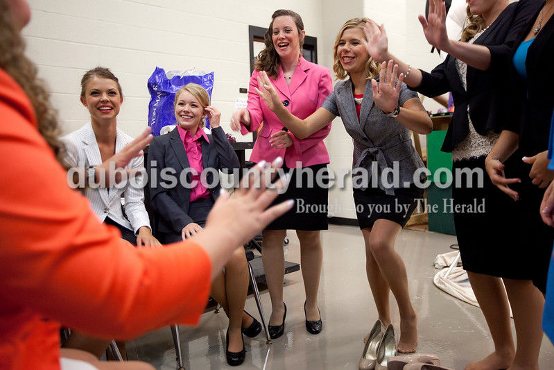 Miss Strassenfest contestants Shelby Mullen, 19, left, Kendra Kern, 20, Hannah Vollmer, 20, and Samantha Erny, 19, all of Jasper, played a game together before the start  of the pageant at Jasper Middle School on Saturday. Dave Weatherwax/The Herald