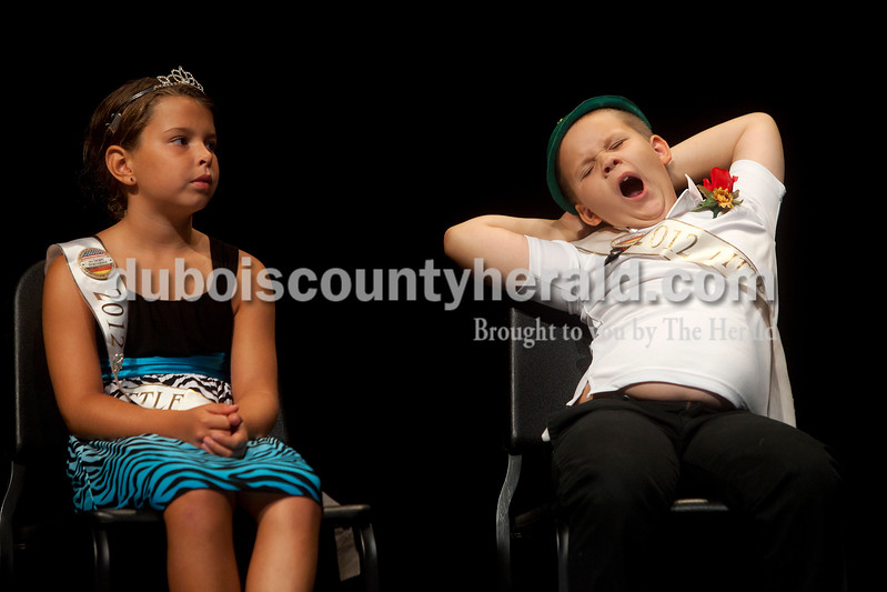 2012 Little Mister Strassenfest Mason Schoenbachler of Jasper, 8, right, couldn't contain the yawns as he sat on stage with 2012 Little Miss Strassenfest Delaney Wigand of Jasper, 9, during the interview portion of Saturday afternoon's contest in the Jasper Middle School auditorium. Dave Weatherwax/The Herald