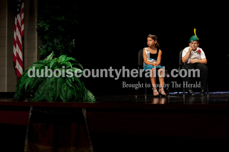 2012 Little Mister Strassenfest Mason Schoenbachler of Jasper, 8, right, played with his scepter as he and 2012 Little Miss Strassenfest Delaney Wigand of Jasper, 9, sat on stage during the interview portion of the contest Saturday afternoon in the Jasper Middle School auditorium. Dave Weatherwax/The Herald