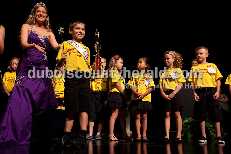 2012 Miss Strassenfest Charlotte Olson of Jasper, left, presented to the crowd 2013 Little Mister Strassenfest Ethan Schaefer of Jasper, 7, on Saturday afternoon in the Jasper Middle School auditorium.  Dave Weatherwax/The Herald