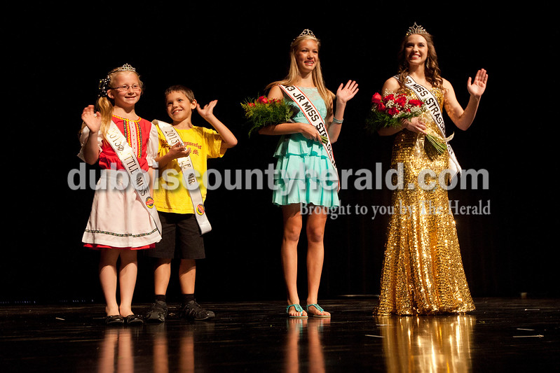 Little Miss Strassenfest Serenidy Eckerle, 7, left, Little Mister Ethan Schaefer, 7, Junior Miss Strassenfest Lydia Shepherd, 14, and Miss Strassenfest Mallory Humbert, 19, all of Jasper, waived to the crowd at the Jasper Middle School auditorium following the pageant Saturday night. Dave Weatherwax/The Herald